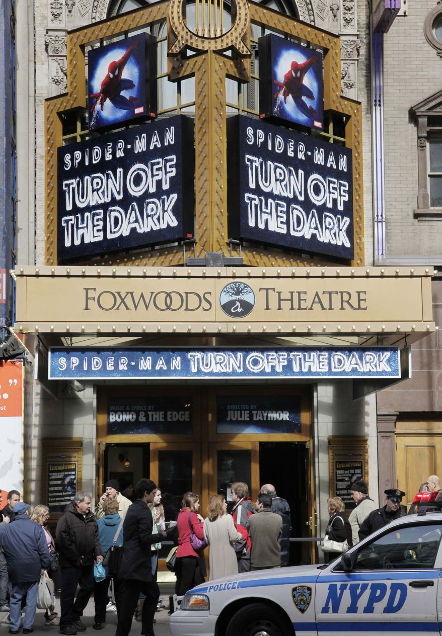 """People line up to enter the Foxwoods Theatre for a matinee showing of """"Spider-Man: Turn Off the Dark,"""" Wednesday, March 9, 2011 in New York. (AP Photo/Mark Lennihan)"""