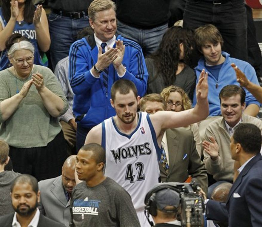 Minnesota Timberwolves Kevin Love acknowledged the cheers of the crowd Wednesday March 9, 2011 after he broke an NBA record with 52 straight games with double figures in rebounds and points against the Indian Pacers. (AP Photo/The Star Tribune, Marlin Levison)