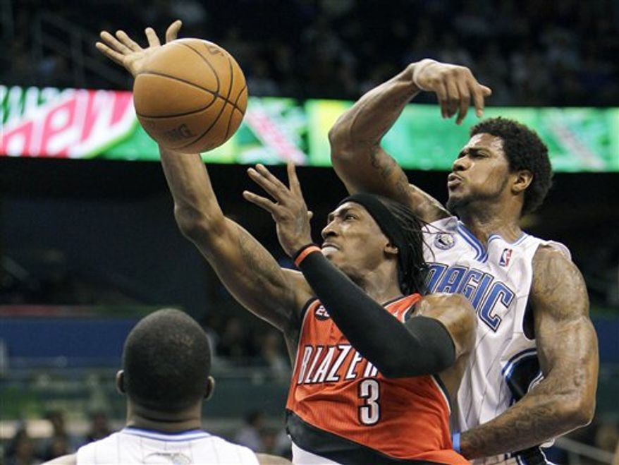 Orlando Magic coach Stan Van Gundy questions a call by an official during the second half of an NBA basketball game against the Portland Trail Blazers in Orlando, Fla., Monday, March 7, 2011. Portland won 89-85. (AP Photo/John Raoux)