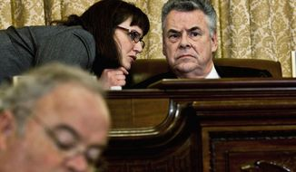 """Rep. Peter T. King, New York Republican and chairman of the House Homeland Security Committee, confers Thursday with an aide during a hearing, """"The Extent of Radicalization in the American Muslim Community and that Community's Response."""" He said it was the first in a series of such hearings. (Drew Angerer/The Washington Times)"""