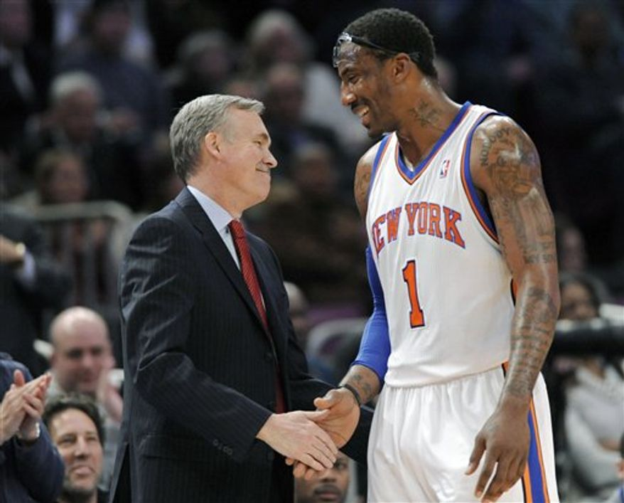 New York Knicks coach Mike D'Antoni, left, shakes hands with Amar'e Stoudemire as Stoudemire leaves the game in the third quarter of an NBA basketball game against the Utah Jazz at Madison Square Garden,  Monday, March 7, 2011, in New York. Stoudemire scored 31 points in the Knicks 131-109 win over the Jazz. (AP Photo/Bill Kostroun)