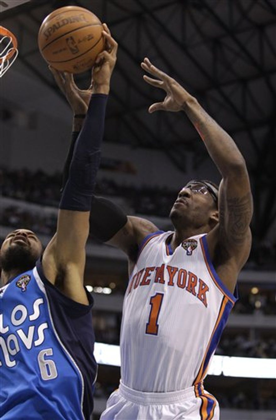 Dallas Mavericks' Tyson Chandler (6) strips the ball from New York Knicks' Amare Stoudemire (1) on a shot attempt in the first half of an NBA basketball game Thursday, March 10, 2011, in Dallas. (AP Photo/Tony Gutierrez)