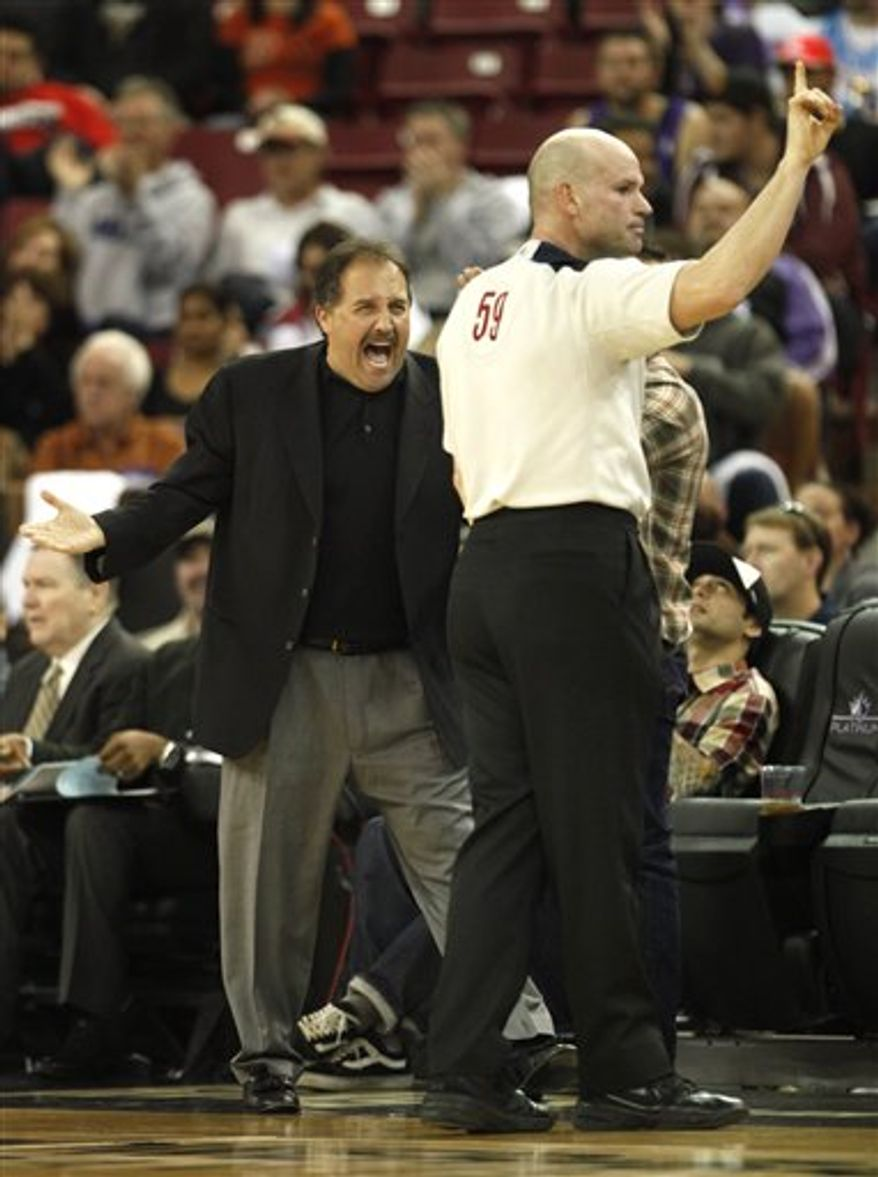Orlando Magic head coach Stan Van Gundy, left,  protests a foul called against his team to offical Gary Zielinski during the fourth quarter of an NBA basketball game in Sacramento, Calif., Wednesday, March 9, 2011.  The Magic won 106-102.(AP Photo/Rich Pedroncelli)