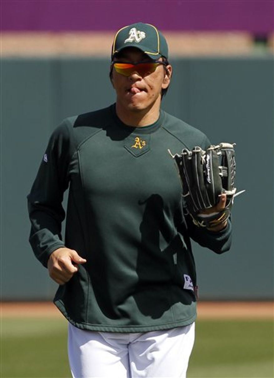 Oakland Athletics' Hideki Matsui of Japan, warms up before a spring training baseball game against the Kansas City Royals in Phoenix, Thursday, March 10, 2011. (AP Photo/Chris Carlson)