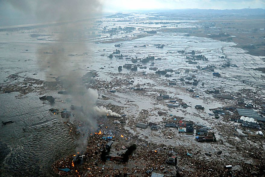 Shores are submerged in Natori city, Miyagi prefecture (state), Japan, after a ferocious tsunami spawned by one of the largest earthquakes ever recorded, slammed Japan's eastern coasts Friday, March 11, 2011. (AP Photo/Kyodo News)