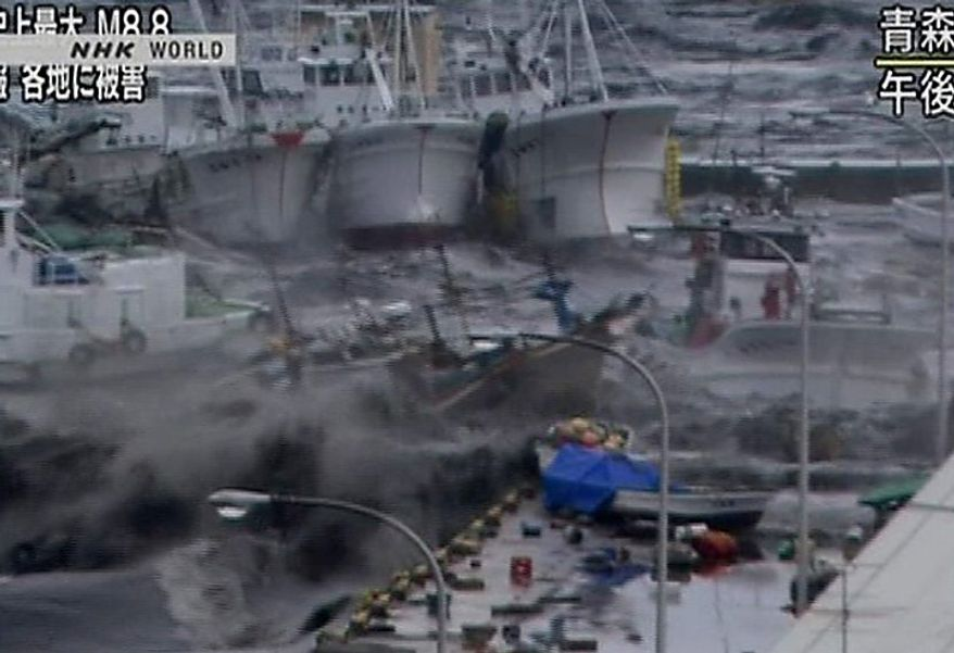 In this video image taken from Japan's NHK TV, a tsunami surge throws boats against a building in Hachinoche, Aomori Prefecture, Japan Friday March 11, 2011 following a massive earth quake. A magnitude 8.9 earthquake slammed Japan's northeastern coast Friday, unleashing a 13-foot (4-meter) tsunami that swept boats, cars, buildings and tons of debris miles inland. Fires triggered by the quake burned out of control up and down the coast.  (AP PHOTO/NHK TV)