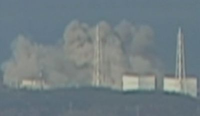 In this video image taken from NTV Japan via APTN, smoke raises from Fukushima Daiichi power plant's Unit 1 in Okumamachi, Fukushima prefecture, Japan, Saturday, March 12, 2011. (AP Photo/NTV Japan via APTN)