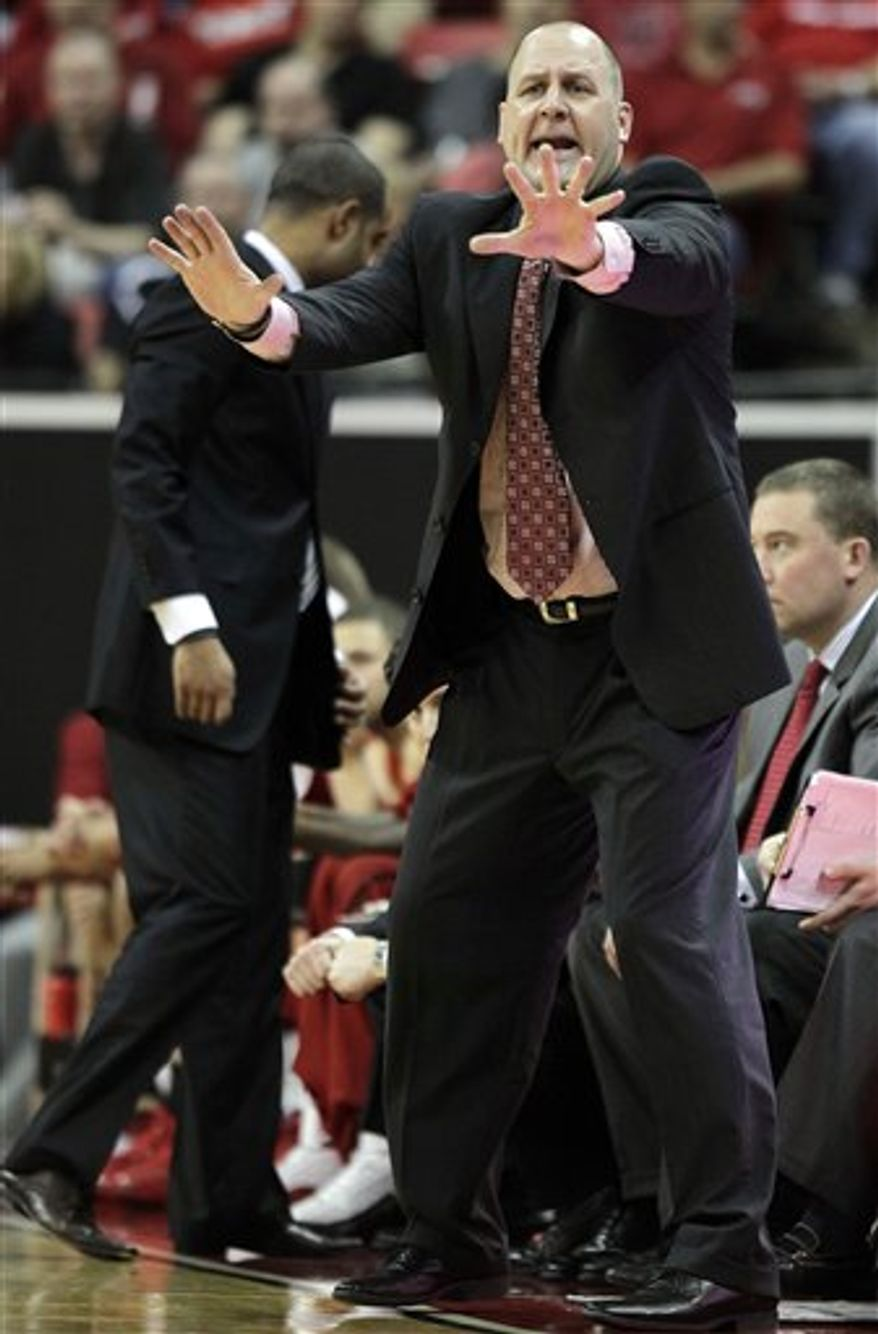 Utah coach Jim Boylen motions to players during the second half of an NCAA college basketball game against San Diego State in the second round of the Mountain West Conference tournament on Thursday, March 10, 2011, in Las Vegas. San Diego State won 64-50. (AP Photo/Julie Jacobson)