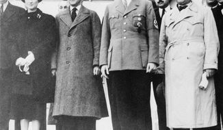 The Duke of Windsor stands between German dictator Adolf Hitler and the Duchess of Windsor in October, 1937, during a controversial visit to Germany. (Associated Press)