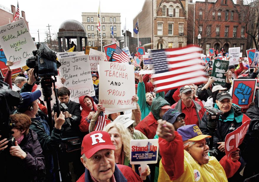 Demonstrators wave signs and shout as unionized workers and supporters turned out Feb. 25 outside New Jersey's Statehouse in Trenton, N.J., to rally in support of Wisconsin public employees who at the time were locked in a battle over collective-bargaining rights. (Associated Press)