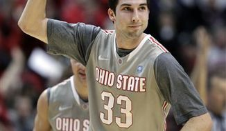 Ohio State guard Jon Diebler  celebrates hitting a 3-point shot at the buzzer to end the first half of an NCAA college basketball game against Penn State in the championship of the Big Ten tournament in Indianapolis, Sunday, March 13, 2011. (AP Photo/AJ Mast)