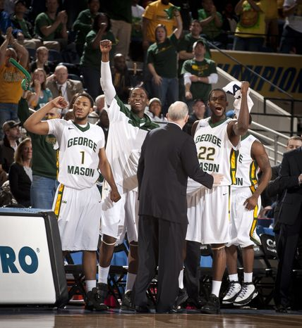 George Mason players cheers teammates during Game 9 against VCI in the NCAA college Colonial Athletic Association college basketball tournament in Richmond, Va., Sunday, March 6, 2011. (AP Photo/Scott K. Brown)