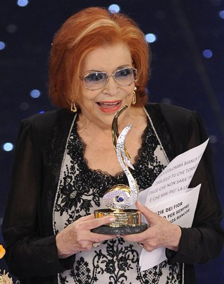 """FILE - Nilla Pizzi performs in this 1963 file photo. Nilla Pizzi, winner of the first San Remo festival, and whose voice was deemed too sensual to sing on radio during the fascist regime of Benito Mussolini, died on Saturday, March 12, 2011. She was 91, said RAI state TV, which broadcasts the week-long festival of Italian song each year. The Italian President Giorgio Napolitano in a condolence message hailed Pizza as a """"sensitive and popular interpreter of the Italian melodic tradition."""" During fascist rule in the years before World War II, Pizzi was kept away from radio work because her voice was deemed too """"modern, exotic and sensual,"""" the Italian news agency said. (AP Photo/Lapresse, File) ITALY OUT"""