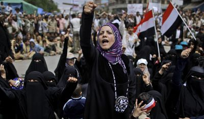 A female anti-government protester chants slogans demanding the resignation of Yemeni President Ali Abdullah Saleh following clashes with Yemeni police in Sanaa, Yemen, on Saturday, March 12, 2011. (AP Photo/Muhammed Muheisen)