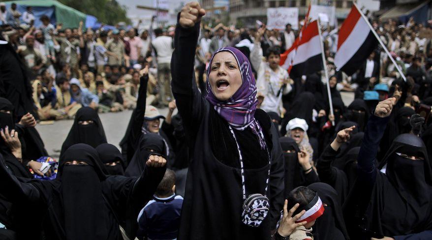 A female anti-government protester chants slogans demanding the resignation of Yemeni President Ali Abdullah Saleh following clashes with Yemeni police in Sanaa, Yemen, on Saturday, March 12, 2011. (AP Photo/Muhammed Muheisen)