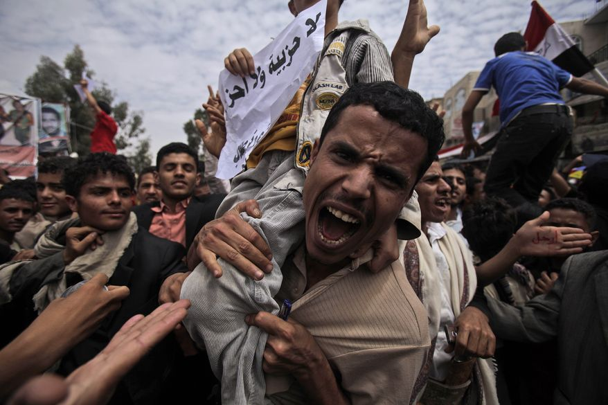 An anti-government protester shouts during a demonstration to demand the resignation of Yemeni President Ali Abdullah Saleh in Sanaa, Yemen, on Sunday, March 13, 2011. (AP Photo/Muhammed Muheisen)