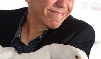 FILE - In this June 14, 2010 file photo, Gilbert Gottfried arrives with the Aflac duck to the 14th Annual Webby Awards in New York. Aflac on Monday, March 14, 2011 announced that it has severed ties with Gottfried over jokes about the earthquake and tsunami in Japan that the comedian posted on Twitter. (AP Photo/Charles Sykes, File)