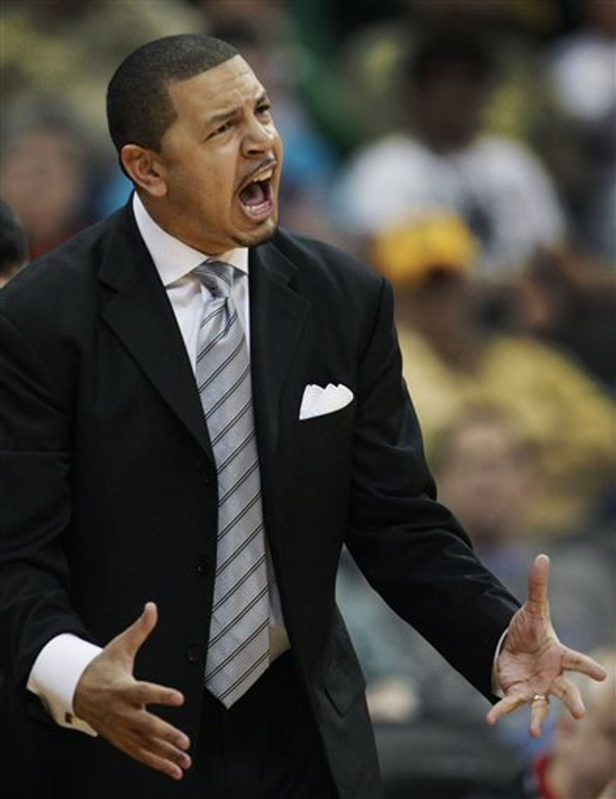 Oklahoma coach Jeff Capel instructs his team during the first half of an NCAA basketball game against Baylor in the first round of the Big 12 men's tournament in Kansas City, Mo., Wednesday, March 9, 2011. (AP Photo/Orlin Wagner)