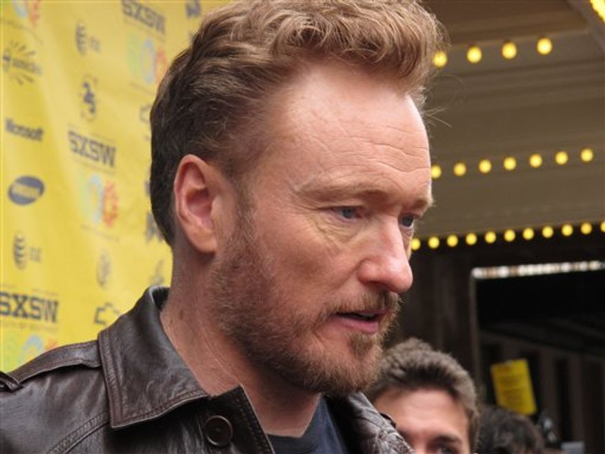 """Conan O'Brien attends  the South by Southwest premiere of """"Conan O'Brien Can't Stop,""""  a documentary that captured the days after his departure from the """"Tonight Show,"""" Sunday, March 13, 2011, Austin, Texas. (AP Photo/April Castro)"""