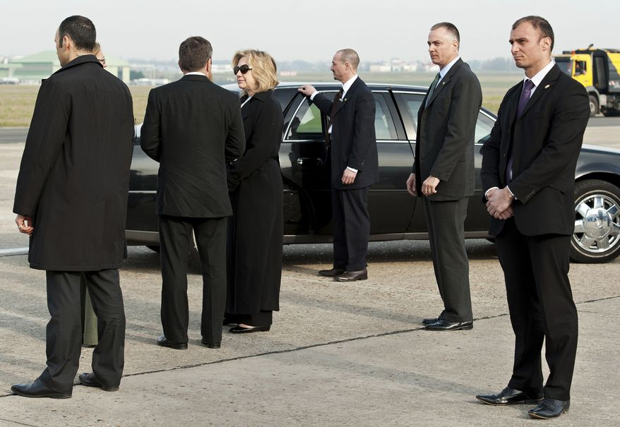 Secretary of State Hillary Rodham Clinton arrives at Le Bourget Airport north of Paris on Monday, March 14, 2011, for talks with European and other leaders on the crisis in Libya. (AP Photo/Paul J Richards, Pool)