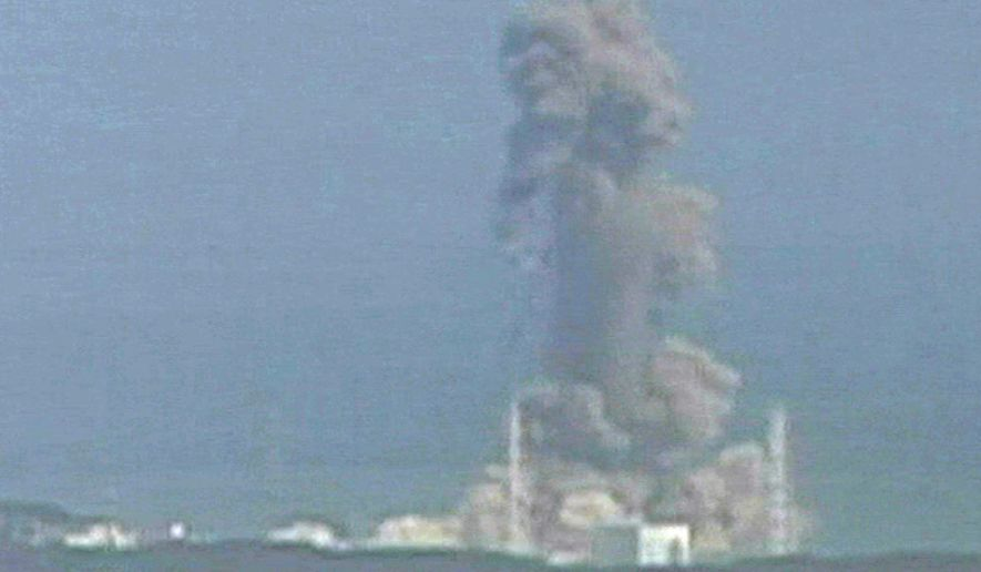 In this image made from Japan's NTV/NNN Japan television footage, smoke ascends from the Fukushima Dai-ichi nuclear plant's Unit 3 in Okumamachi, Fukushima Prefecture, in northern Japan on Monday, March 14, 2011. The second hydrogen explosion in three days rocked the stricken nuclear plant Monday, sending a massive column of smoke into the air and wounding 11 workers. (AP Photo/NTV/NNN Japan)