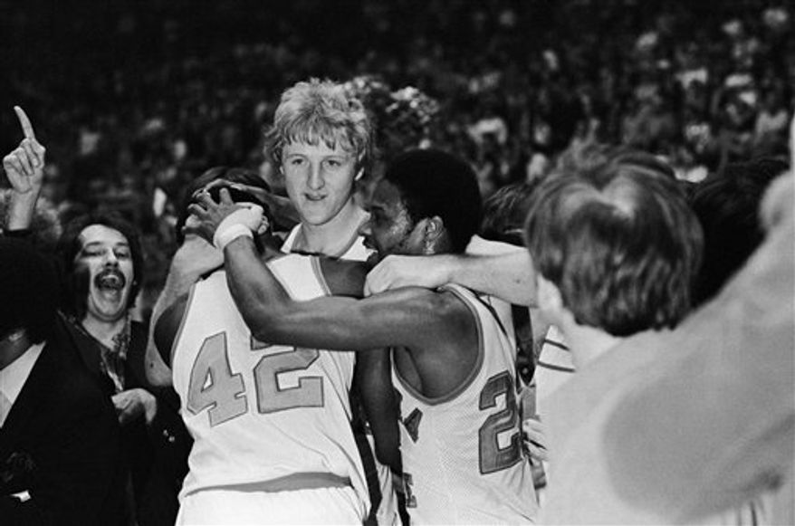 FILE - This March 19, 1979, file photo shows Indiana State star Larry Bird, center facing camera,  embracing teammates Alex Gilbert, left, and Carl Nicks after the Sycamores beat Arkansas, 73-71, for the NCAA Midwest Regional crown,  in Cincinnati. Living in the shadow of Larry Legend isn't always easy, but it is part of being a Sycamore.  (AP Photo/File)