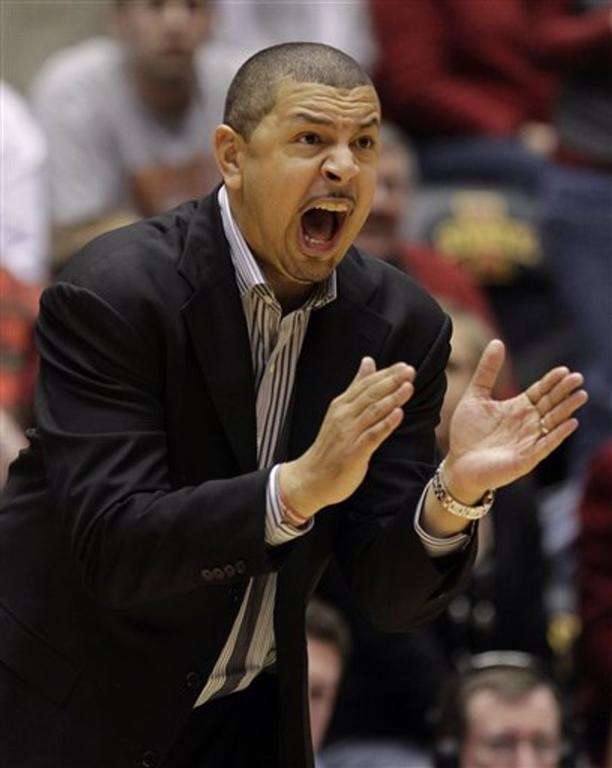 FILE - This Jan. 29, 2011, file photo shows Oklahoma coach Jeff Capel yelling to his team during the second half of an NCAA college basketball game against Iowa State, in Ames, Iowa.  Oklahoma fired Capel on Monday, March 14, 2011,  after he followed a trip to the NCAA tournament's regional finals with the program's first back-to-back losing seasons since 1967. (AP Photo/Charlie Neibergall, File)