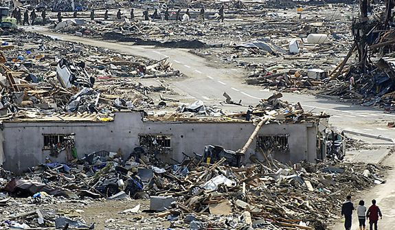The city center sits devastated by a strong earthquake and tsunami in Rikuzentakata, in Japan's Iwate Prefecture, on Monday, March 14, 2011. (AP Photo/Kyodo News)