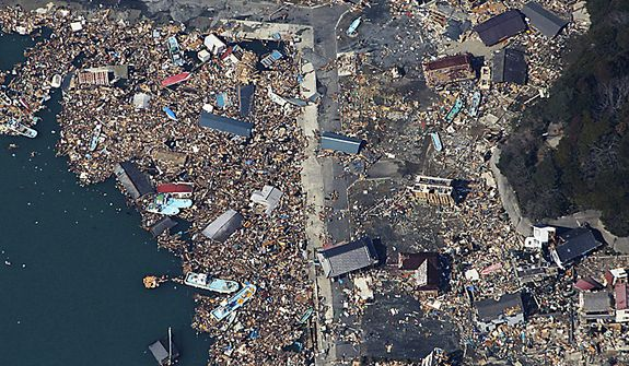 Debris covers part of a fishing port on Izushima island in Onagawacho, Japan, on Monday, March 14, 2011, three days after a powerful earthquake-triggered tsunami hit the country's northeast coast. (AP Photo/The Yomiuri Shimbun, Atsushi Taketazu)