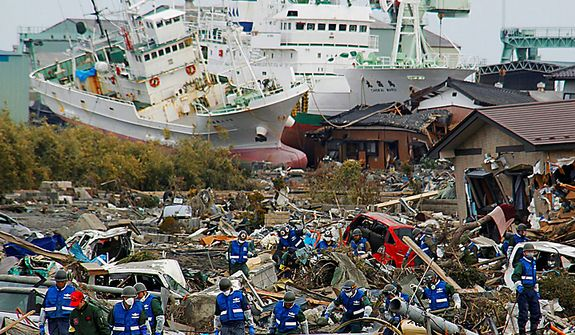 Soldiers of the Japan Self-Defense Force and firefighters search for the victims in the rubble on Monday, March 14, 2011, in Matsushima, Miyagi Prefecture, Japan, three days after northeastern coastal towns were devastated by an earthquake and tsunami. (AP Photo/Kyodo News)