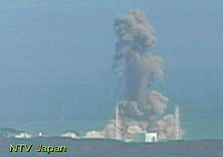 In this image made frp, Japan's NTV/NNN Japan television footage, smoke ascends from the Fukushima Dai-ichi nuclear plant's Unit 3 in Okumamachi, Fukushima Prefecture, in northern Japan, on Monday, March 14, 2011. The second hydrogen explosion in three days rocked Japan's stricken nuclear plant, sending a massive column of smoke into the air and wounding 11 workers. (AP Photo/NTV/NNN Japan)