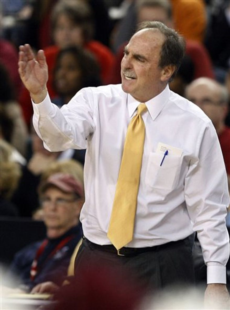 Temple head coach Fran Dunphy shouts to his players during the second half of an NCAA college basketball semifinal game against Richmond in the Atlantic 10 men's tournament in Atlantic City, N.J., Saturday, March 12, 2011. Richmond won 58-54. (AP Photo/Mel Evans)