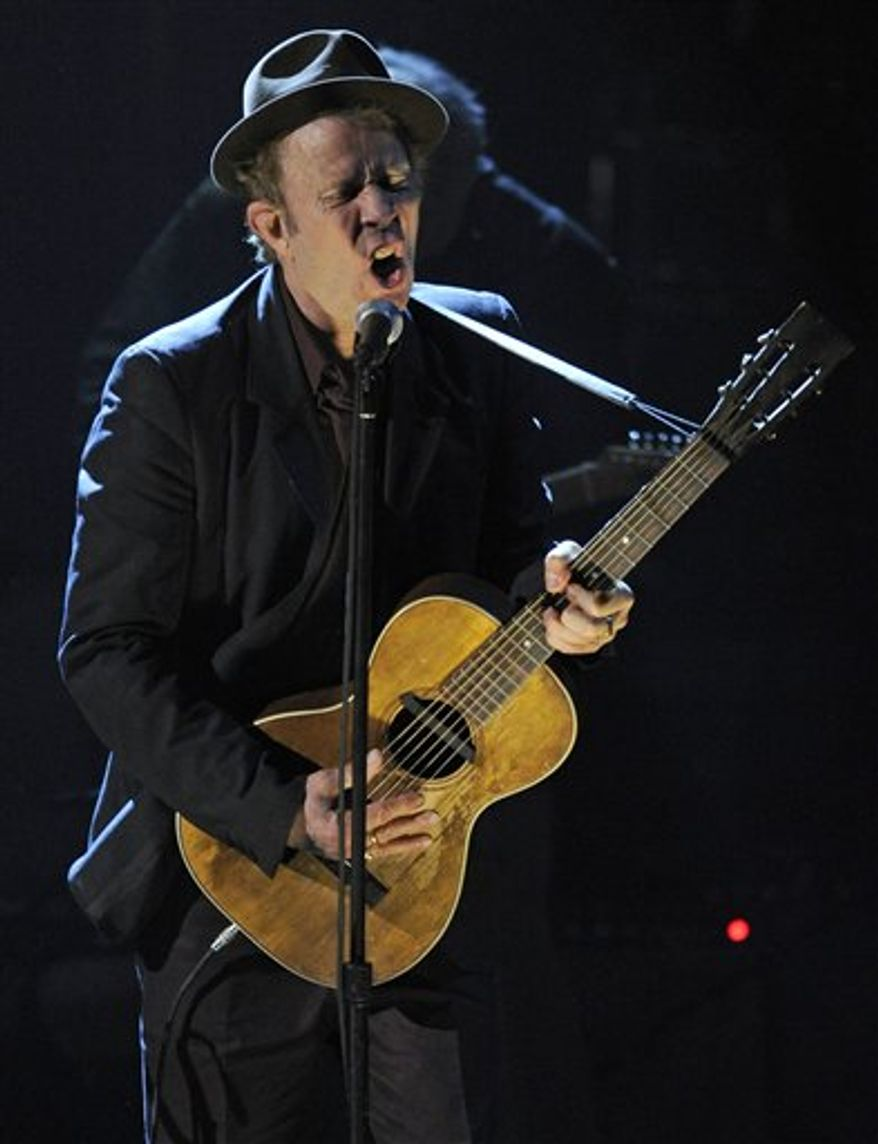 Inductee Tom Waits performs at the Rock and Roll Hall of Fame induction ceremony, Monday, March 14, 2011, in New York.  (AP Photo/Evan Agostini)