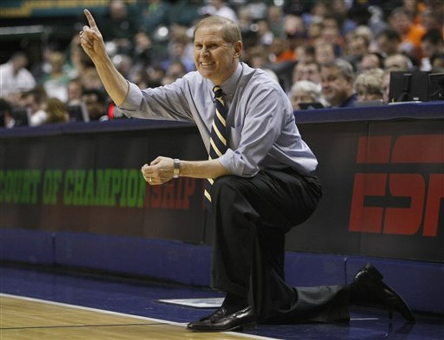 Illinois head coach Bruce Weber directs his team in the second half of an NCAA college basketball game at the Big Ten Conference tournament in Indianapolis, Friday, March 11, 2011. Michigan beat Illinois 60-55. (AP Photo/Kiichiro Sato)