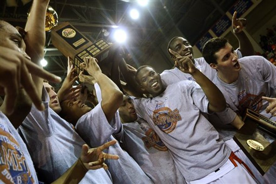 Bucknell men's basketball players carry the Patriot League Championship trophy off the court after defeating Lafayette at the NCAA college basketball game in Lewisburg, Pa. on Friday, March 11, 2011. Bucknell won 72-57. (AP Photo/Ralph Wilson)
