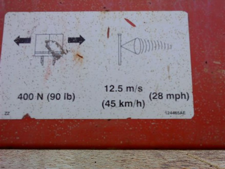 In this photo provided by the Indiana Department of Labor on March 15, 2011, shows a warning sign on a lift at the scene of an accident that killed Notre Dame student Declan Sullivan in South Bend, Ind., Oct. 27, 2010 while he filmed Notre Dame football practice.  Indiana state regulators have found that the University of Notre Dame did not maintain safe working conditions when Sullivan, a 20-year-old junior film student, died as he filmed football practice from a hydraulic lift that toppled in extreme high winds. (AP Photo/Indiana Department of Labor)