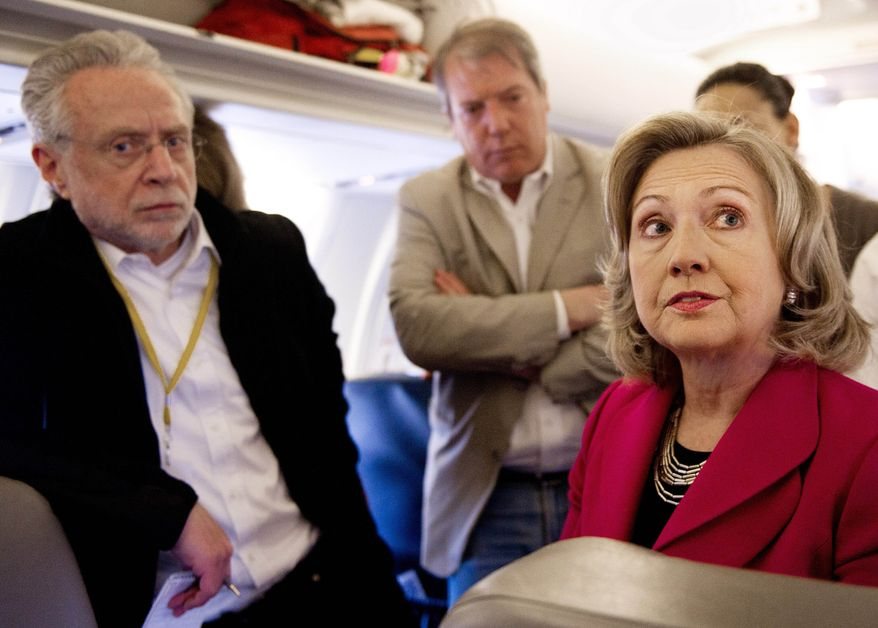 Secretary of State Hillary Rodham Clinton speaks with reporters aboard her aircraft on her way from Paris to Cairo on Tuesday, March 15, 2011. Mrs. Clinton was expected to press Egypt's transitional leaders to follow through on pledges for democratic reform after the ouster of longtime autocratic President Hosni Mubarak in a popular revolt. (AP Photo/Paul J. Richards, Pool)