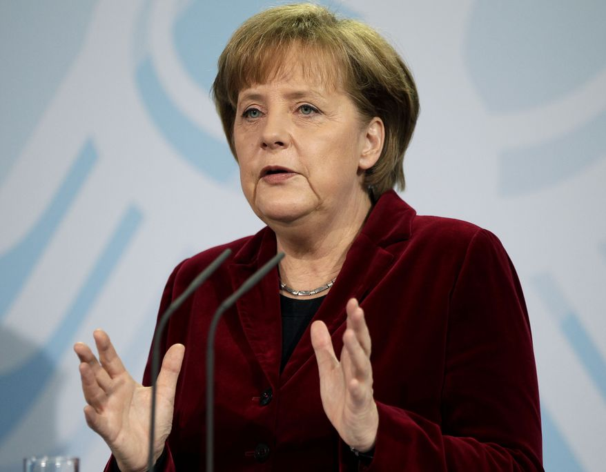 German Chancellor Angela Merkel speaks during a joint news conference with Vice Chancellor Guido Westerwelle in Berlin on Monday, March 14, 2011, at which the government said it is suspending for three months a decision to extend the life of its nuclear power plants. (AP Photo/Michael Sohn)