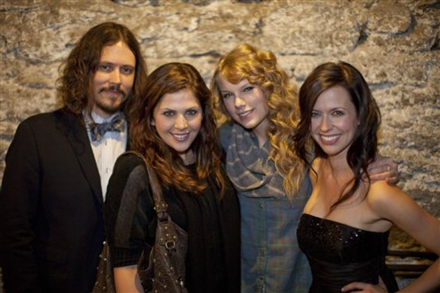 In this Feb. 2, 2011 photo released by Tec Petaja, John Paul White, left, and Joy Williams, right, of The Civil Wars, pose with Hillary Scott of Lady Antebellum, second left, and Taylor Swift  in Nashville. (AP Photo/Tec Petaja)