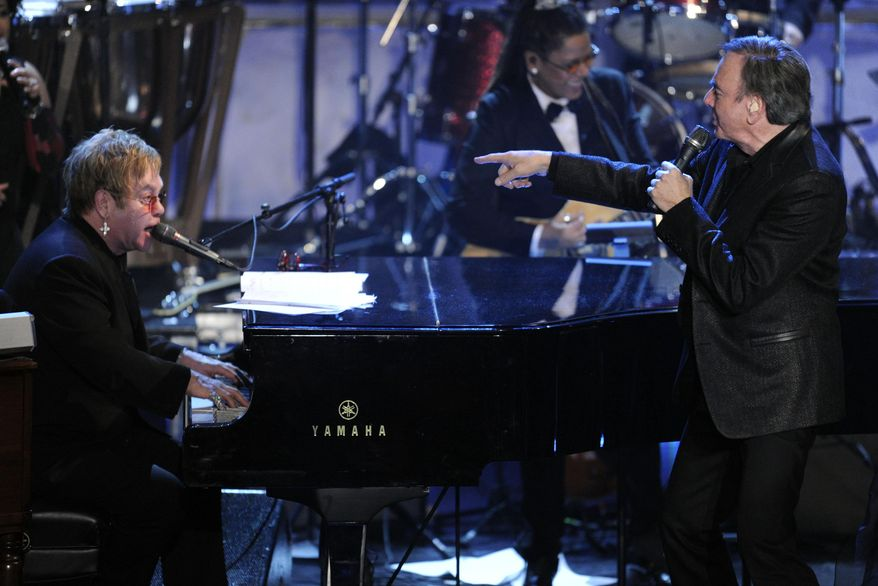Inductee Neil Diamond, right, and Elton John perform at the Rock and Roll Hall of Fame induction ceremony, Tuesday, March 15, 2011, in New York. (AP Photo/Evan Agostini)