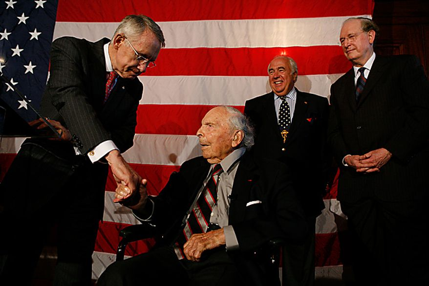 ** FILE ** The United States Senate holds a ceremony to honor Frank Woodruff Buckles (seated), at 107 the oldest living American veteran of World War I, at the U.S. Capitol in Washington on June 18, 2008. From left are Senate Majority Leader Harry Reid, Nevada Democrat; Richard Rovsek, organizer of the event; and Sen. John D. Rockefeller IV, West Virginia Democrat. (The Washington Times)