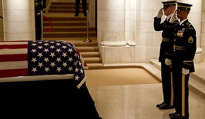 "The U.S. Army's 3rd Infantry Regiment, ""The Old Guard,"" changes the guard as the body of former Army Cpl. Frank Woodruff Buckles, the last surviving American veteran of World War I, lies in honor in the Memorial Amphitheater Chapel at Arlington National Cemetery in Arlington, Va., on Tuesday, March 15, 2011. He died on Sunday, Feb. 27, 2011, at his West Virginia home at age 110. Mr. Buckles enlisted in the Army on Aug. 14, 1917, at the age of 16; he was discharged in 1920. (Rod Lamkey Jr./The Washington Times)"