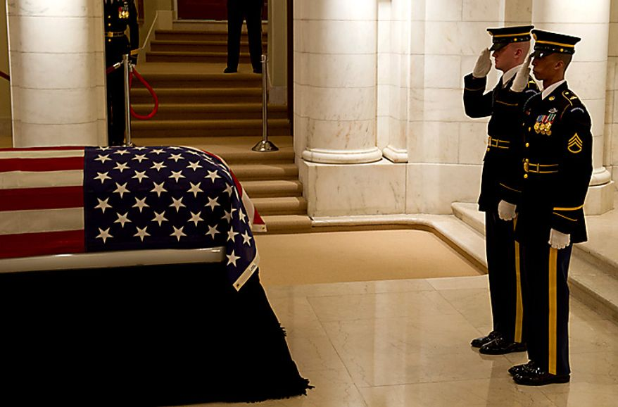"""The U.S. Army's 3rd Infantry Regiment, """"The Old Guard,"""" changes the guard as the body of former Army Cpl. Frank Woodruff Buckles, the last surviving American veteran of World War I, lies in honor in the Memorial Amphitheater Chapel at Arlington National Cemetery in Arlington, Va., on Tuesday, March 15, 2011. He died on Sunday, Feb. 27, 2011, at his West Virginia home at age 110. Mr. Buckles enlisted in the Army on Aug. 14, 1917, at the age of 16; he was discharged in 1920. (Rod Lamkey Jr./The Washington Times)"""