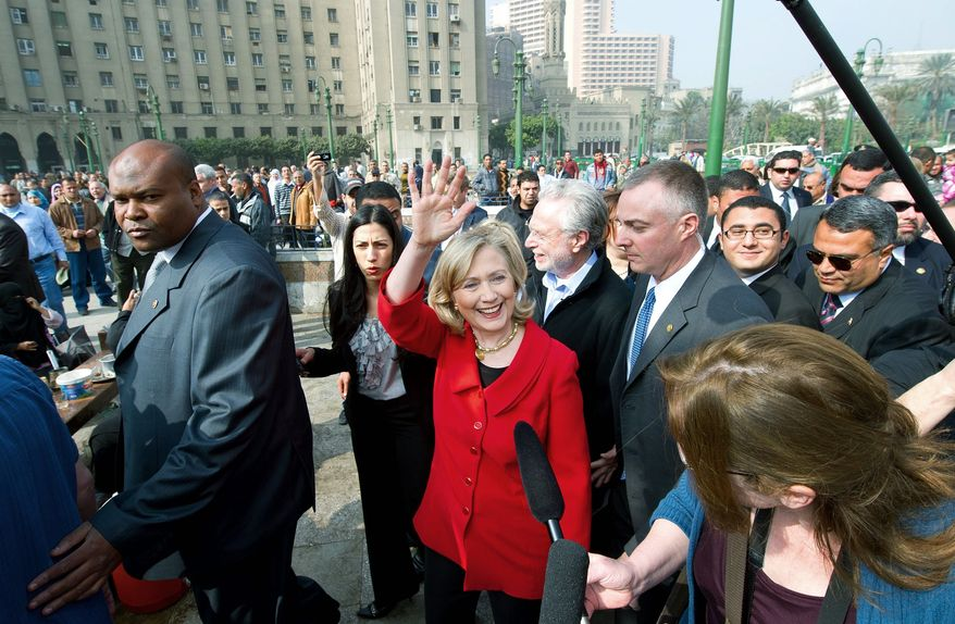 U.S. Secretary of State Hillary Rodham Clinton acknowledges the crowd during an unannounced walk Wednesday through Tahrir Square in Cairo. The square was the epicenter of the uprising that toppled Egypt's longtime autocratic leader last month. (Associated Press)