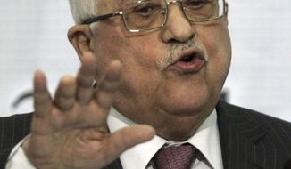 Palestinian President Mahmoud Abbas speaks at a Fatah central council meeting in the West Bank city of Ramallah, Wednesday, March 16, 2011. Abbas said Wednesday he will not run for re-election. (AP Photo/Majdi Mohammed)