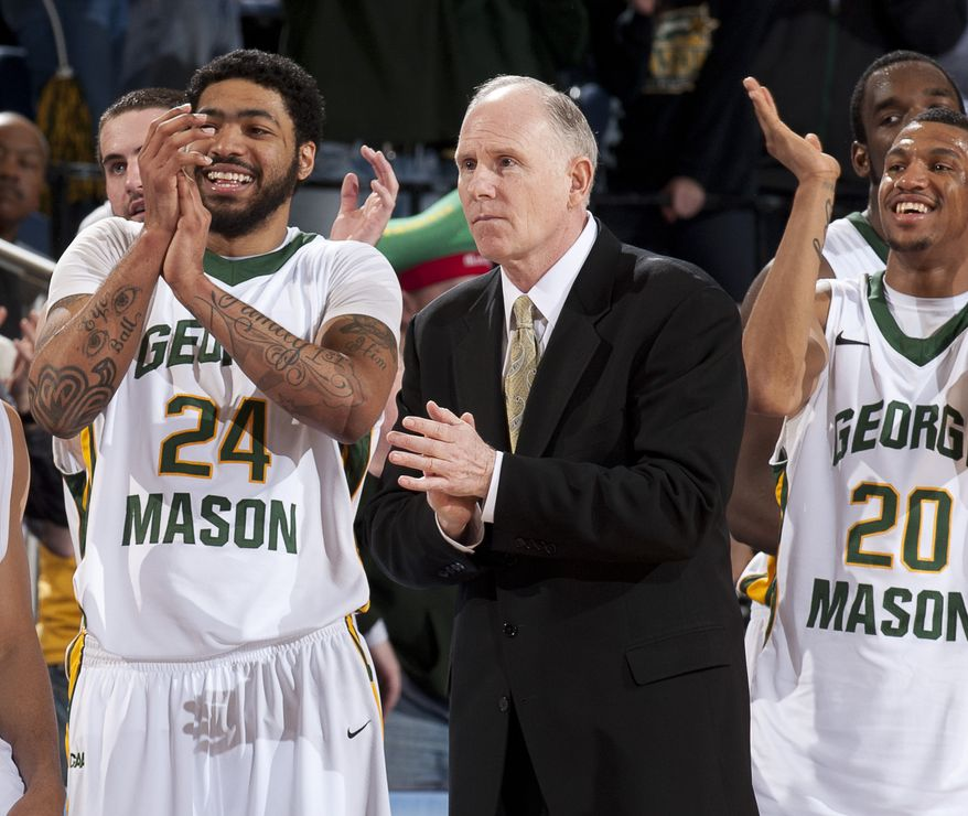 George Mason's coach Jim Larranaga, center, watches along with players Ryan Pearson (24) and Cam Long (20) as time runs out in their 68-45 win over Georgia State in an NCAA college basketball game in quarterfinal round play in the Colonial Athletic Association college basketball tournament in Richmond, Va., Saturday, March 5, 2011 (AP Photo/Scott K. Brown)