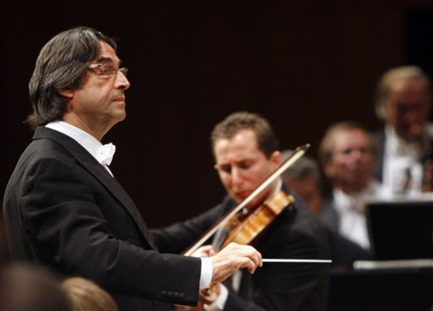 """FILE - This Sept. 8, 2008 file photo shows Maestro Riccardo Muti leading the Vienna Philharmonics, in Lucerne, Switzerland. It isn't every day that a conductor concedes an encore for an opera chorus. Even rarer is asking the audience to sing it, but maestro Riccardo Muti has just done so for the love of homeland. Muti swirled about on his podium late Saturday, March 12, 2011 to face the audience during Giuseppe Verdi's """"Nabucco'' at Rome's Teatro dell'Opera when shouts of """"bis!'' (encore!) rang out.  (AP Photo/Keystone, Sigi Tischler, file)"""