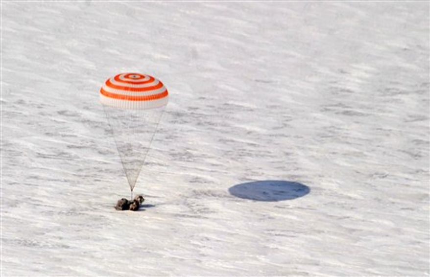 US astronaut Scott Kelly is seen inside of Russian Soyuz TMA-01M spacecraft shortly after their landing near the town of Arkalyk in northern Kazakhstan, Wednesday, March 16, 2011. NASA astronaut Scott Kelly and two Russian cosmonauts landed safely Wednesday in the snowy expanses of central Kazakhstan after spending a five-month stint on the International Space Station.(AP Photo/Sergei Remezov, Pool)