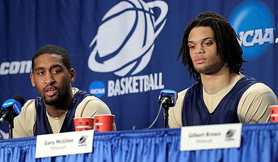 Pittsburgh guard Brad Wanamaker, left, speaks as center Gary McGhee listens during a news conference in Washington, D.C., Wednesday, March 16, 2011. Pittsburgh will play North Carolina-Asheville in a second-round Southeast Regional NCAA college basketball tournament game Thursday. (AP Photo)