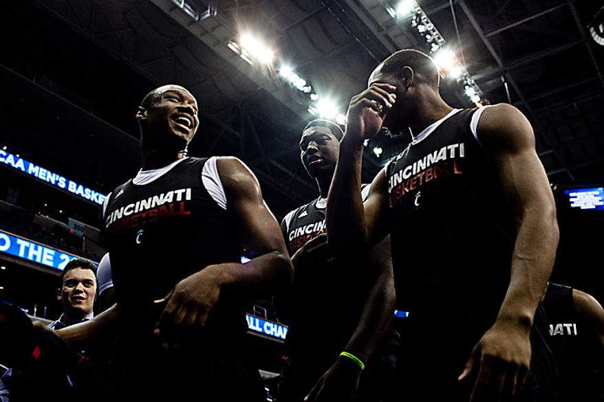 The University of Cincinnati basketball team leaves the court following their open practice at the Verizon Center,in Washington, D.C.,  Wednesday, March 16, 2011. (Drew Angerer/The Washington Times)
